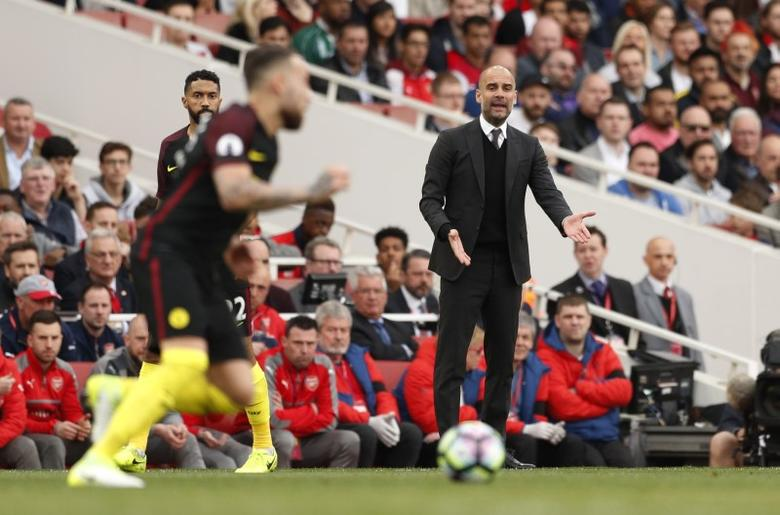 Britain Football Soccer - Arsenal v Manchester City - Premier League - Emirates Stadium - 2/4/17 Manchester City manager Pep Guardiola looks on as Manchester City's Nicolas Otamendi is in action Action Images via Reuters / John Sibley Livepic
