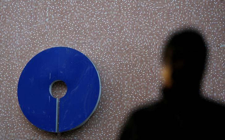 FILE PHOTO -  A man walks past a logo of State Bank of India outside a branch in New Delhi, India, February 1, 2017. REUTERS/Adnan Abidi/File Photo