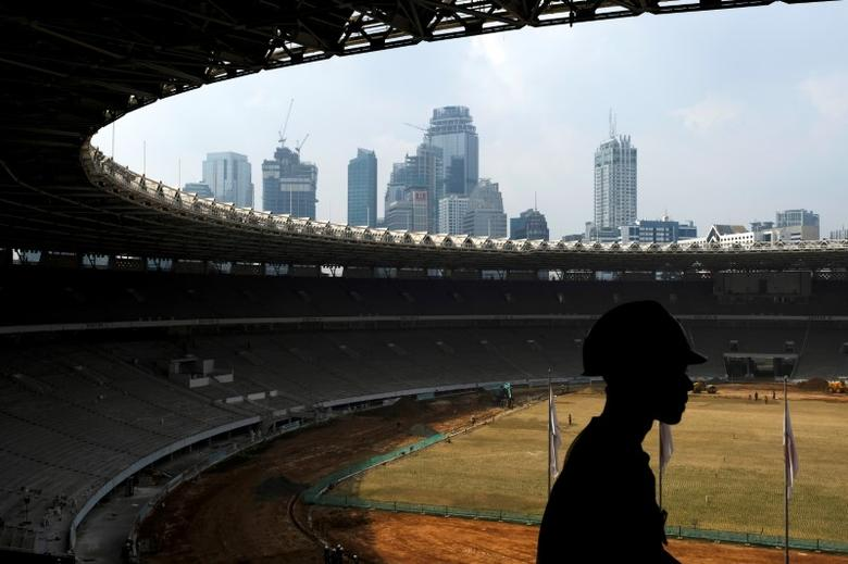 A worker walks during renovation of the Bung Karno stadium ahead for 2018 Asian Games in Jakarta, Indonesia, March 17, 2017.  REUTERS/Beawiharta