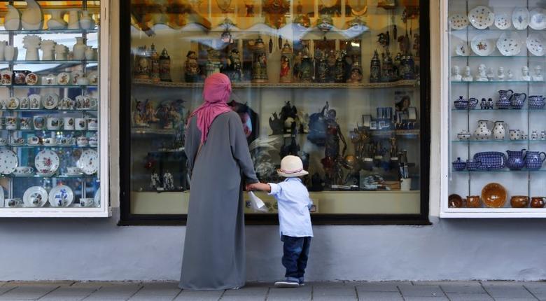 A woman wears a burka while visiting Garmisch-Partenkirchen, Germany August 16, 2016. REUTERS/Michaela Rehle