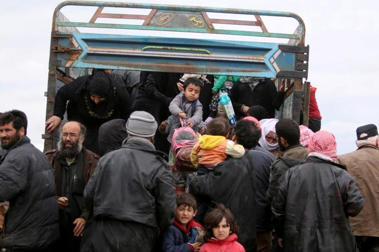 FILE PHOTO: Internally displaced Syrian people who fled Raqqa city get out of a truck at a camp in Ain Issa, Raqqa Governorate, Syria April 1, 2017. REUTERS/Rodi Said