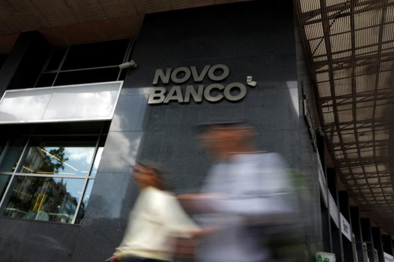 People pass by a Novo Banco branch in Lisbon, Portugal March 31, 2017. REUTERS/Pedro Nunes