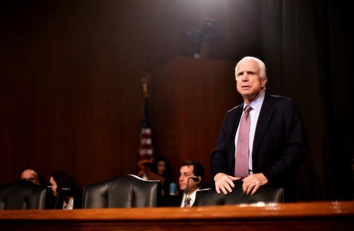 FILE PHOTO --  U.S. Senator John McCain (R-AZ) takes his seat before hearing testimony to the Senate Select Intelligence Committee on the nomination of former U.S. Senator Dan Coats (R-IN) to be Director of National Intelligence in Washington, U.S., February 28, 2017. REUTERS/James Lawler Duggan/File Photo