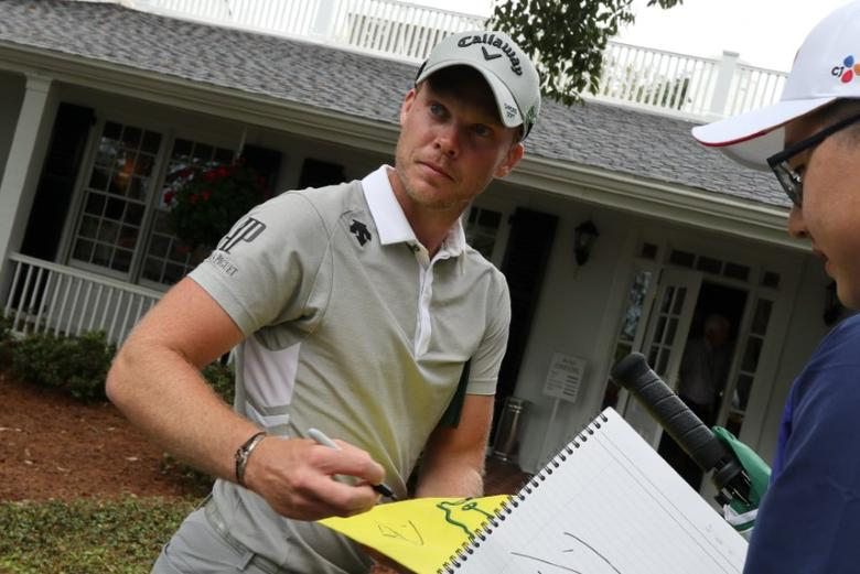 Danny Willett of England signs an autograph during Monday practice rounds for the 2017 Masters at Augusta National Golf Course in Augusta, Georgia, U.S., April 3, 2017. REUTERS/Jonathan Ernst