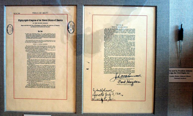 FILE PHOTO: The actual Title VII of the Civil Rights Act of 1964 document and pen is on display in the East Room of the White House in Washington, DC, U.S. on July 1, 2004.   REUTERS/Mannie Garcia/File Photo