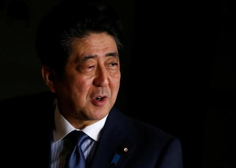 Japan's Prime Minister Shinzo Abe speaks to the media as he walks at his official residence in Tokyo, Japan, March 16, 2017.   REUTERS/Toru Hanai