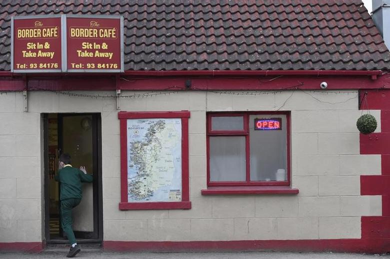 A boy walks into a restaurant called the Border Cafe in the the border town of Muff, Ireland February 10, 2016. REUTERS/Clodagh Kilcoyne