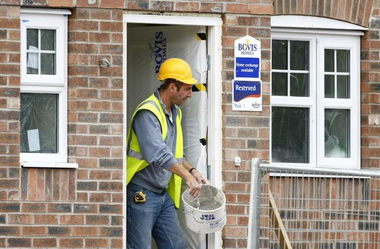 FILE PHOTO - A builder works at a Bovis homes housing development near Bolton, Britain, July 9, 2008. REUTERS/Phil Noble/File Photo