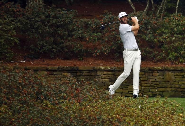 Apr 5, 2017; Augusta, GA, USA; Dustin Johnson hits a tee shot on the 13th hole during a practice round at Augusta National Golf Club. Mandatory Credit: Rob Schumacher-USA TODAY Sports