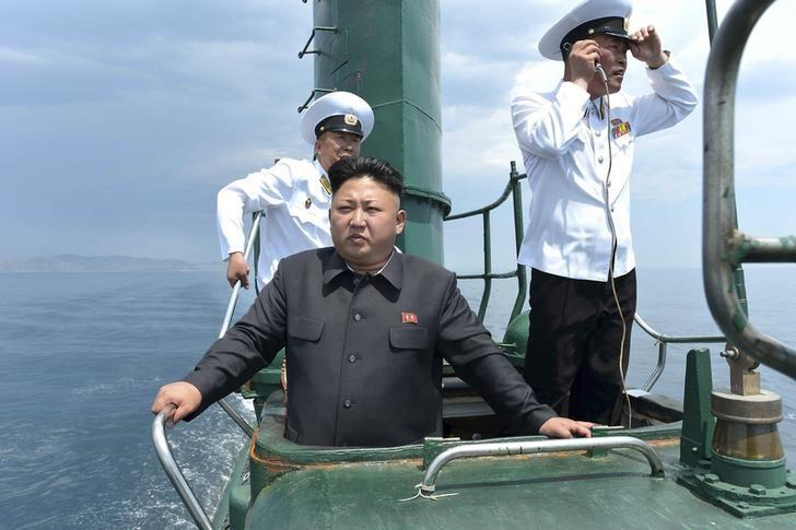 North Korean leader Kim Jong Un (front) stands on the conning tower of a submarine during his inspection of the Korean People's Army (KPA) Naval Unit 167 in this undated photo released by North Korea's Korean Central News Agency (KCNA) in Pyongyang June 16, 2014. REUTERS/KCNA/Files