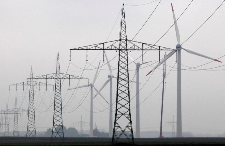 Maintenance work is done on a Vestas wind turbine (R) at a wind energy park near Heide, Germany, September 9, 2010.  REUTERS/Christian Charisius/File Photo