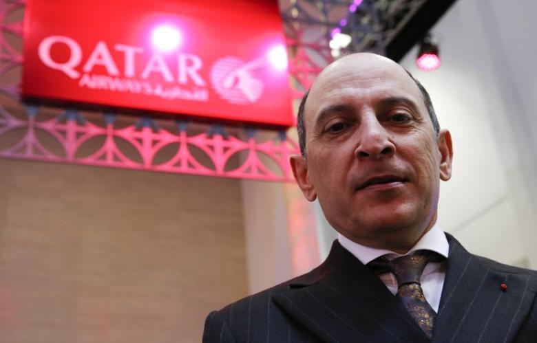 Qatar Airways Chief Executive Akbar Al Baker tours the stand of the company at the International Tourism Trade Fair (ITB) in Berlin, Germany, March 9, 2016.   REUTERS/Fabrizio Bensch