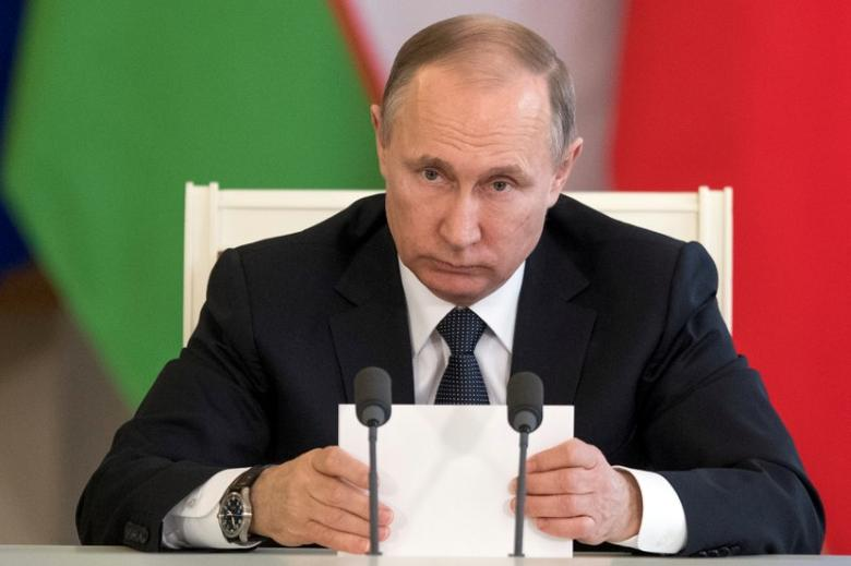 Russian President Vladimir Putin attends a meeting with Uzbek President Shavkat Mirziyoyev (not pictured) in Moscow's Kremlin, Russia April 5, 2017. REUTERS/Pavel Golovkin/Pool