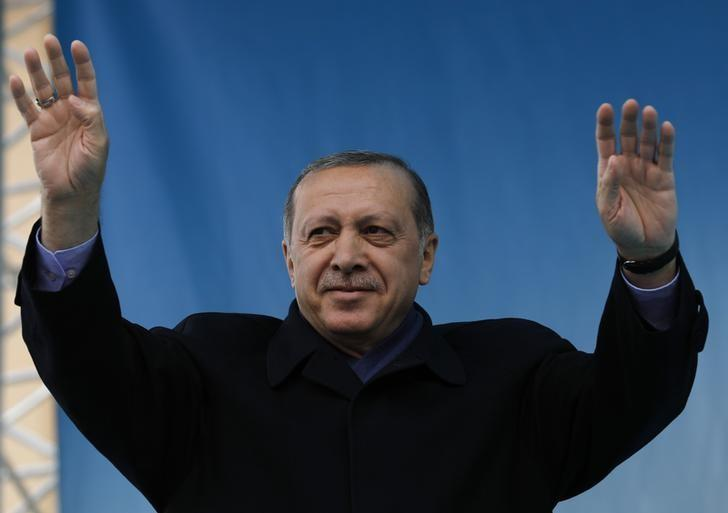 Turkish President Tayyip Erdogan greets his supporters during a rally for the upcoming referendum in the Black Sea city of Rize, Turkey, April 3, 2017. REUTERS/Umit Bektas