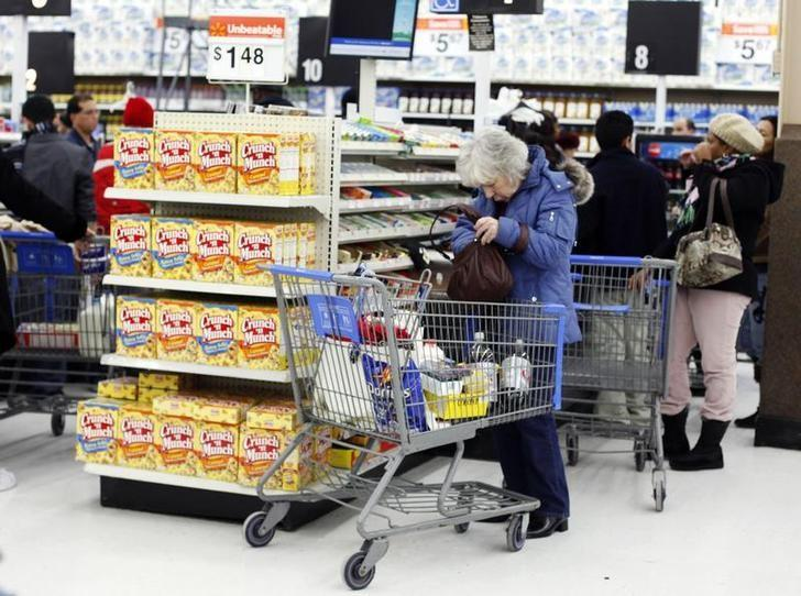 A woman shops at the Walmart in Westbury, New York, February 17, 2010. Wal-Mart Stores Inc, the world's biggest retailer, releases its fourth quarter earnings report on on Thursday, February 18. REUTERS/Shannon Stapleton/Files