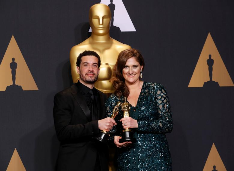 FILE PHOTO: Ezra Edelman and Caroline Waterlow hold their Best Feature Documentary Oscars for O.J: Made in America, at the 89th Academy Awards, Hollywood, California, U.S. February 26, 2017.  REUTERS/Lucas Jackson/File Photo