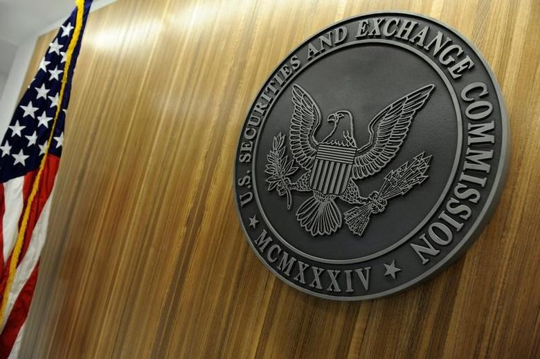 FILE PHOTO: The seal of the U.S. Securities and Exchange Commission hangs on the wall at SEC headquarters in Washington, DC, U.S. on June 24, 2011.    REUTERS/Jonathan Ernst/File Photo