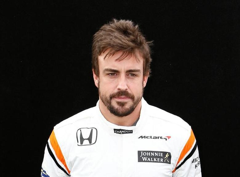 Formula One - F1 - Australian Grand Prix - Melbourne, Australia - 23/03/2017 McLaren driver Fernando Alonso of Spain poses during the driver portrait session at the first race of the year.     REUTERS/Brandon Malone -