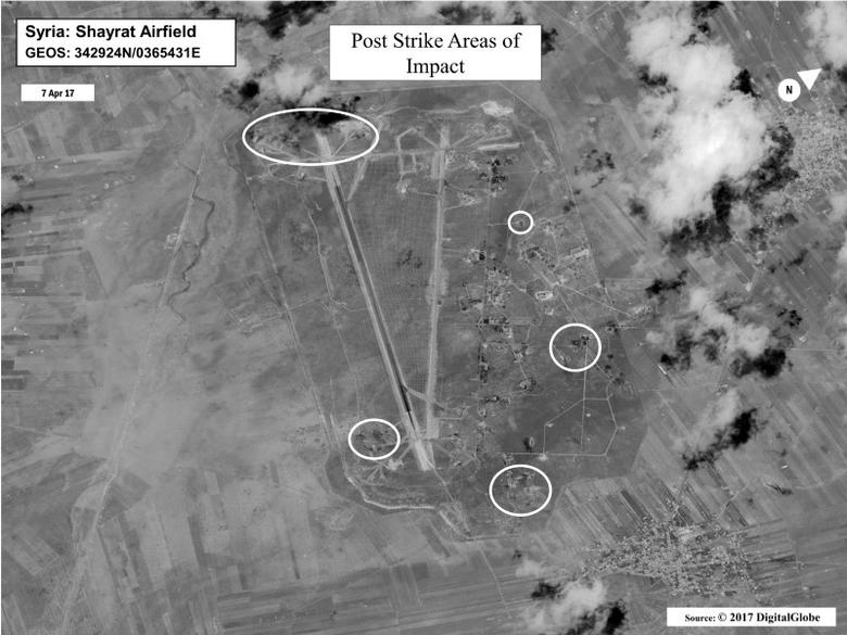 Battle damage assessment image of Shayrat Airfield, Syria, is seen in this DigitalGlobe satellite image, released by the Pentagon following U.S. Tomahawk Land Attack Missile strikes from Arleigh Burke-class guided-missile destroyers, the USS Ross and USS Porter on April 7, 2017.      DigitalGlobe/Courtesy U.S. Department of Defense/Handout via REUTERS