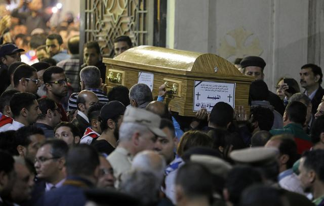 A coffin is carried inside a Coptic church that was bombed on Sunday in Tanta, Egypt, April 9, 2017. REUTERS/Mohamed Abd El Ghany