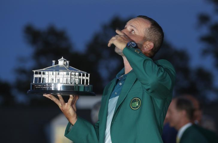 Sergio Garcia of Spain points to the sky as he holds the Masters trophy after winning the 2017 Masters golf tournament at Augusta National Golf Club in Augusta, Georgia, U.S., April 9, 2017. REUTERS/Brian Snyder