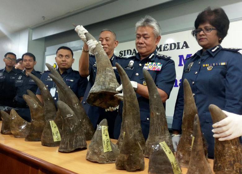 Kuala Lumpur International Airport (KLIA) customs director Hamzah Sundang (2nd R) poses with rhino horns that were seized on April 7 from Mozambique to Kuala Lumpur via Doha, during a news conference at the airport in Sepang, Malaysia April 10, 2017. REUTERS/Rozanna Latiff