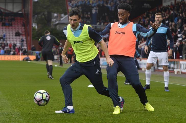 Britain Football Soccer - AFC Bournemouth v Swansea City - Premier League - Vitality Stadium - 18/3/17 Swansea City's Leroy Fer and Jack Cork warm up before the game Reuters / Hannah McKay Livepic/File Photo