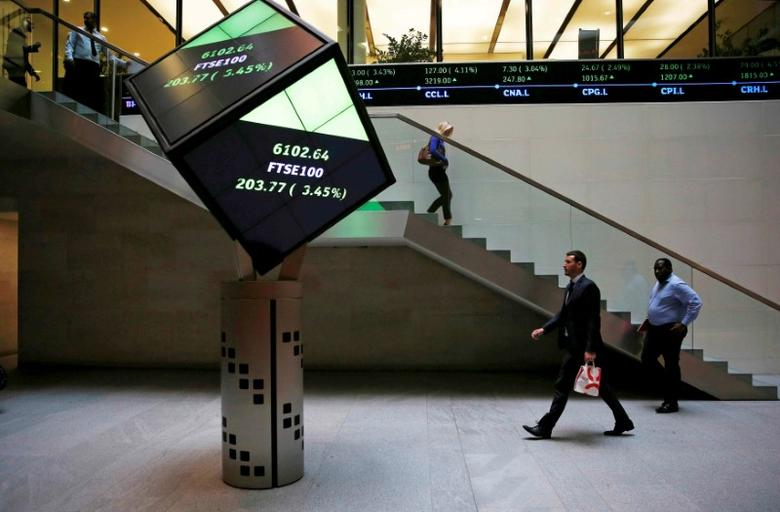 FILE PHOTO: People walk through the lobby of the London Stock Exchange in London, Britain August 25, 2015.  REUTERS/Suzanne Plunkett/File photo