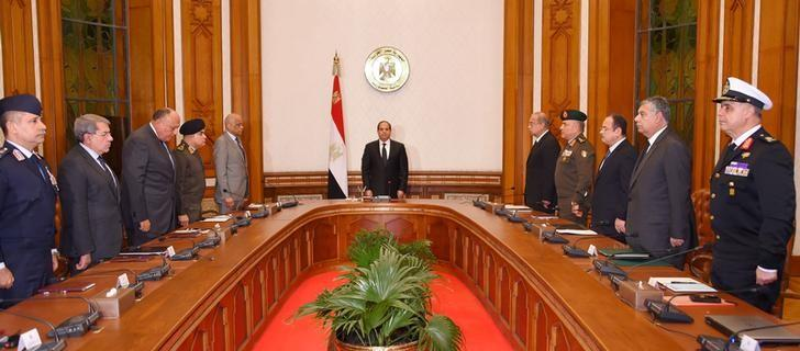 Egyptian President Abdel Fattah al-Sisi (C) stands and observes a minute of silence for the victims of two separate church attacks during Palm Sunday prayers, with leaders of the Supreme Council of the Armed Forces and the Supreme Council for Police to discuss developments in the security situation in Egypt, as well as developments in the country's fight against terrorism, at the Ittihadiya presidential palace in Cairo, Egypt, April 9, 2017, in this handout picture courtesy of the Egyptian Presidency. The Egyptian Presidency/Handout via REUTERS