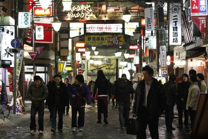 People walk through the Kokubuncho entertainment district in downtown Sendai, Miyagi prefecture, northeastern Japan February 25, 2012. REUTERS/Yuriko Nakao/File Photo