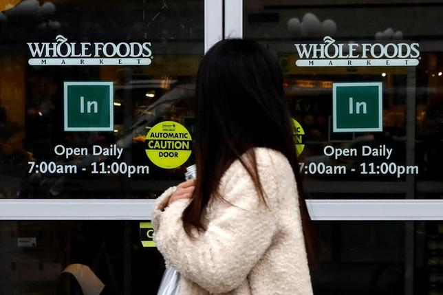 A customer exits a Whole Foods Market in New York City, U.S., February 7, 2017. REUTERS/Brendan McDermid
