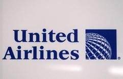 A logo is pictured on a wall during a news conference announcing the merger between Continental Airlines and United Airlines in New York, May 3, 2010. United Airlines parent UAL Corp will buy Continental Airlines Inc for $3.17 billion to form the world's largest carrier, moving to better withstand the hazards that have battered airlines in recent years.  REUTERS/Shannon Stapleton (UNITED STATES - Tags: TRANSPORT BUSINESS)