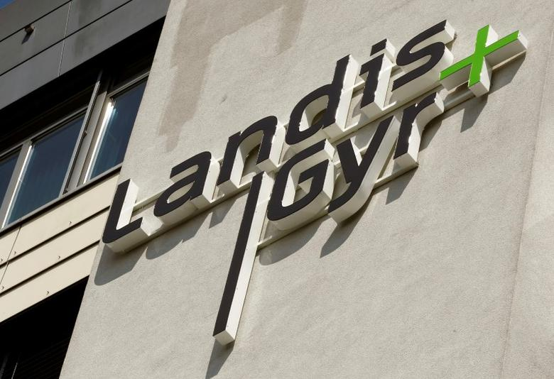 FILE PHOTO -  The logo of Swiss-based meter maker Landis+Gyr is seen at an office building in the Swiss town of Zug May 19, 2011.     REUTERS/Arnd Wiegmann/File Photo
