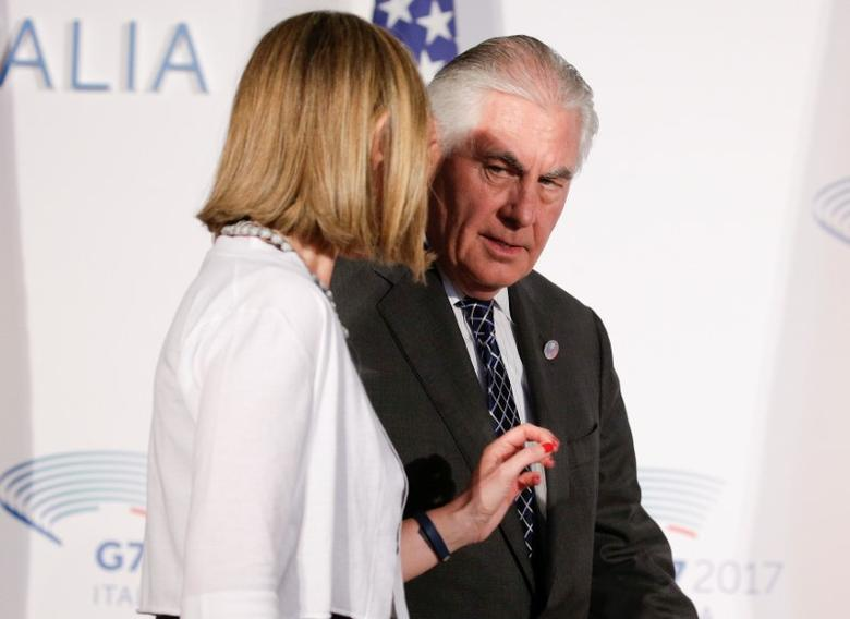 U.S. Secretary of State Rex Tillerson talks with E.U. High Representative for Foreign Affairs Federica Mogherini as they arrive to pose for a family photo during a G7 for foreign ministers in Lucca, Italy April 11, 2017. REUTERS/Max Rossi