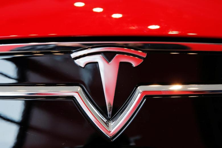 A Tesla logo on a Model S is photographed inside of a Tesla dealership in New York, U.S., April 29, 2016. REUTERS/Lucas Jackson