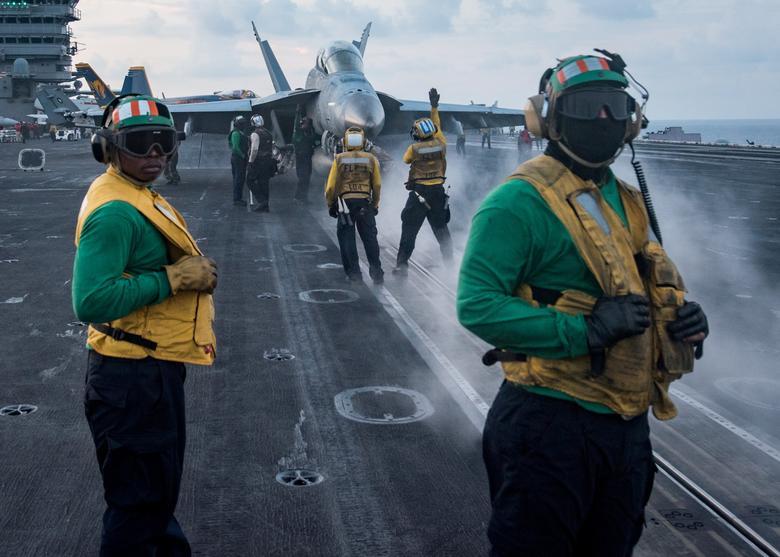 Sailors conduct flight operations on the aircraft carrier USS Carl Vinson (CVN 70) flight deck, in the South China Sea April 8, 2017.  U.S. Navy photo by Mass Communication Specialist 3rd Class Matt Brown/Handout via REUTERS