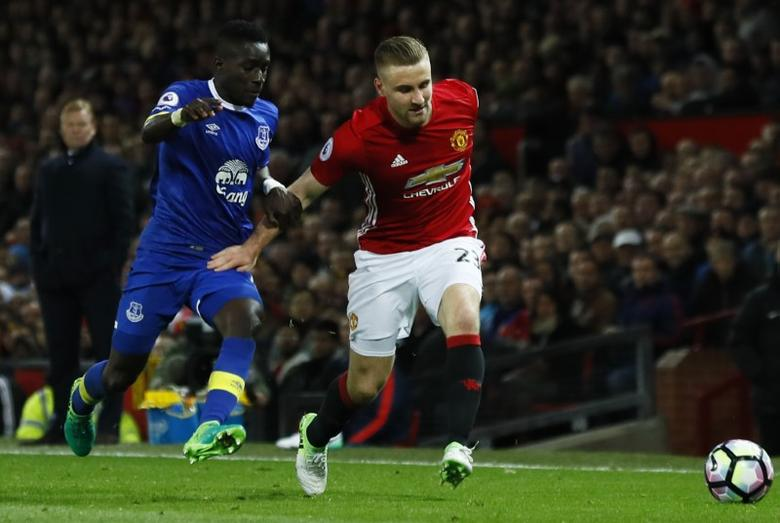 Britain Football Soccer - Manchester United v Everton - Premier League - Old Trafford - 4/4/17 Manchester United's Luke Shaw in action with Everton's Idrissa Gueye  Action Images via Reuters / Jason Cairnduff Livepic