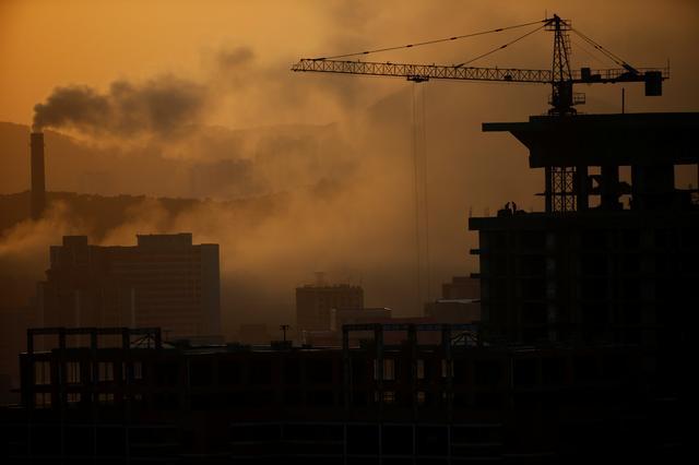 People work atop a building under construction as sun sets in Pyongyang, North Korea April 12, 2017. REUTERS/Damir Sagolj