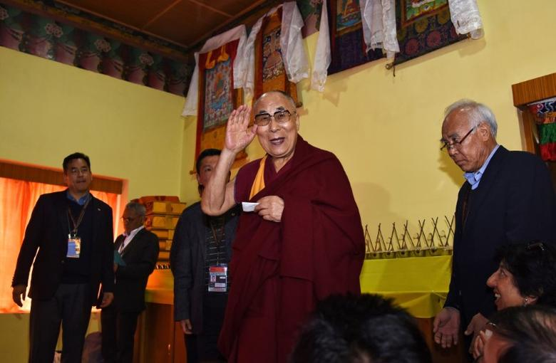 FILE PHOTO: Tibetan spiritual leader Dalai Lama arrives to attend a press conference after delivering teachings at Yiga Choezin, in Tawang, in the northeastern state of Arunachal Pradesh, India April 8, 2017. REUTERS/Anuwar Hazarika