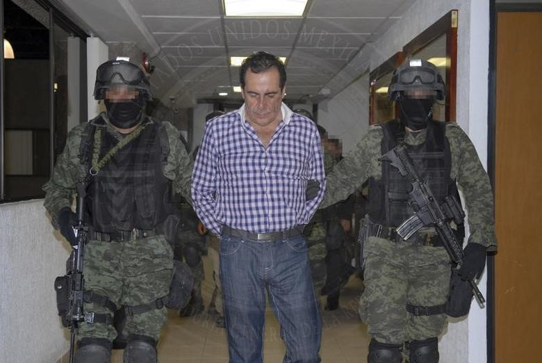 Soldiers escort  Hector Beltran Leyva in Mexico City, in this handout picture taken October 1, 2014   REUTERS/Attorney General's Office/Handout via Reuters