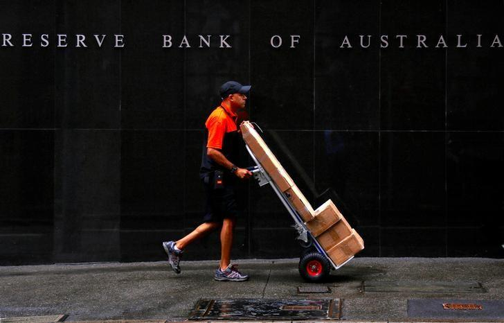 A worker delivering parcels pushes a trolley past the Reserve Bank of Australia building in central Sydney, Australia, March 7, 2017.  REUTERS/David Gray