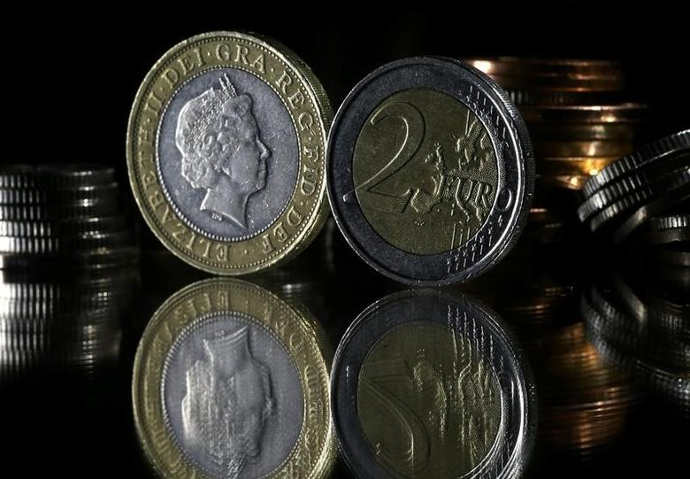 Pound and Euro coins are seen in this picture illustration taken January 18, 2017.  REUTERS/Dado Ruvic/Illustration