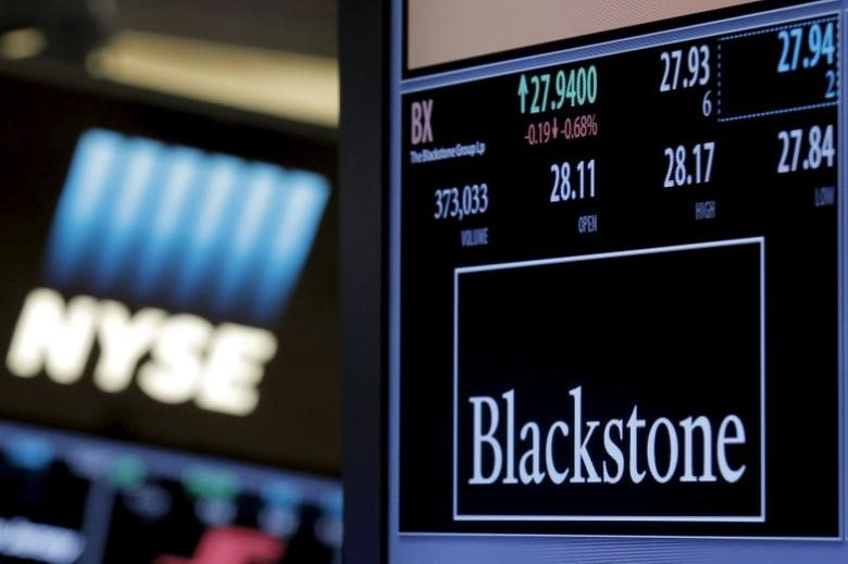 FILE PHOTO - The ticker and trading information for Blackstone Group is displayed at the post where it is traded on the floor of the New York Stock Exchange (NYSE) April 4, 2016. REUTERS/Brendan McDermid