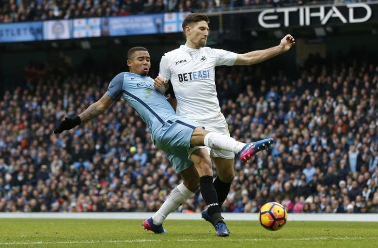 Manchester City v Swansea City - Premier League - Etihad Stadium - 5/2/17 Manchester City's Gabriel Jesus in action with Swansea City's Federico Fernandez  Reuters / Andrew Yates Livepic