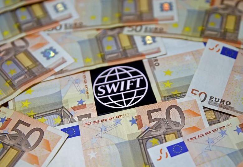FILE PHOTO: Swift code bank logo is displayed on an iPhone 6s among Euro banknotes in this picture illustration January 26, 2016.  REUTERS/Dado Ruvic/File Photo - RTS11WHG