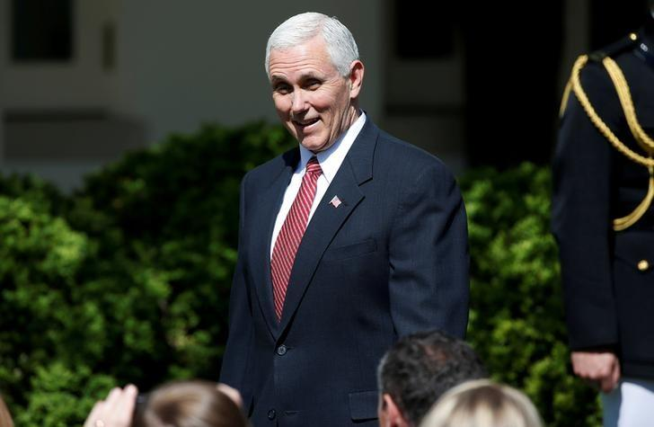 FILE PHOTO: U.S. Vice President Mike Pence arrives for the swearing-in ceremony of Judge Neil Gorsuch as an Associate Supreme Court Justice in the Rose Garden of the White House in Washington, U.S., April 10, 2017.  REUTERS/Joshua Roberts /File Photo