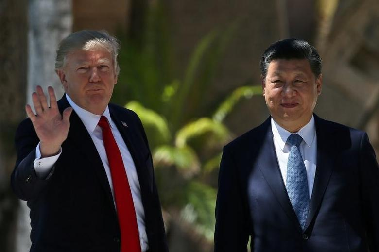 FILE PHOTO: U.S. President Donald Trump waves as he and China's President Xi Jinping walk along the front patio of the Mar-a-Lago estate after a bilateral meeting in Palm Beach, Florida, U.S., April 7, 2017. REUTERS/Carlos Barria/File Photo