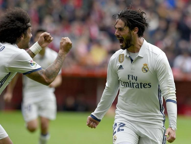 Football Soccer- Spanish La Liga Santander - Sporting v Real Madrid - El Molinon Stadium, Gijon, Spain - 15/04/17 Real Madrid's Francisco ''Isco'' Alarcon (R) celebrates with team mate Marcelo after scoring a goal. REUTERS/Eloy Alonso
