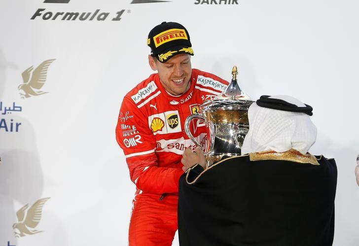 Formula One - F1 - Bahrain Grand Prix - Sakhir, Bahrain - 16/04/17 - First place Ferrari Formula One driver Sebastian Vettel of Germany receives the trophy after winning Bahrain Grand Prix. REUTERS/Hamad I Mohammed