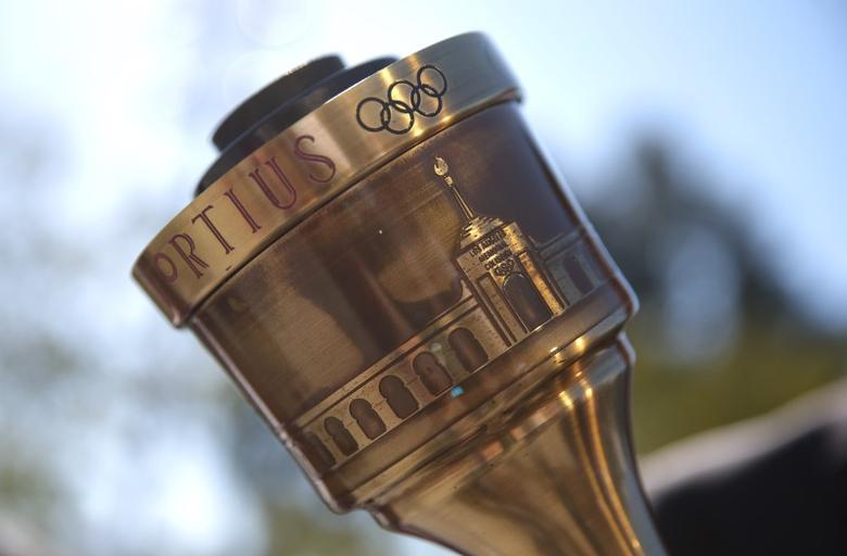 The Olympic torch is shown with a depiction of the Los Angeles Coliseum prior to a news conference to annouce the city's final approval to bid for the 2024 Olympic Games, in Los Angeles, California, January 25, 2017.  REUTERS/Lucy Nicholson